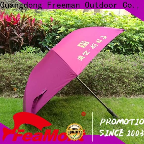 FeaMont printed promotional umbrella application in street