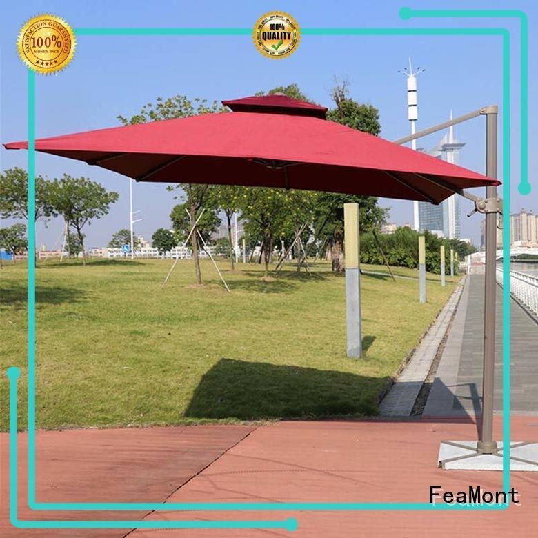 FeaMont hand white garden umbrella for-sale in street