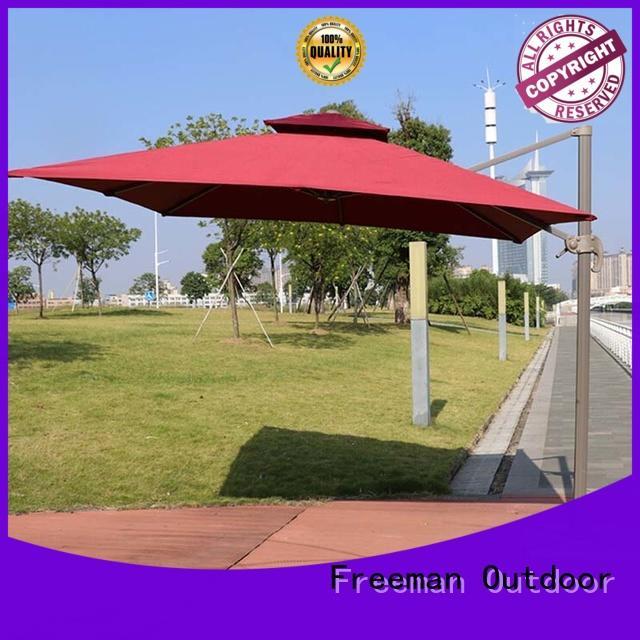 cranking extra large garden umbrella sensing for event Freeman Outdoor